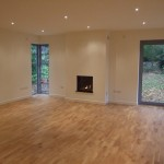 Finished extension show beautiful wooden floor and contemporary inset gas fire