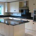 Shaker kitchen showing island & fitted cupboard & wall units
