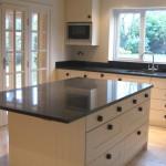 Shaker kitchen with black granite worktops
