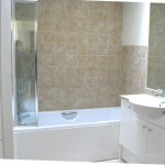 Family bathroom with fitted bathroom sink & storage units