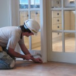 Paul joiner carrying out finishing touches to joinery in dining area