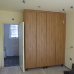 Fitted floor to ceiling wardrobes to spare bedroom