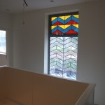New Alumnium window with a contemporary stained glass design inkeeping with Deco house