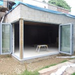 Bi-fold doors view from outside in their fully opened position during build