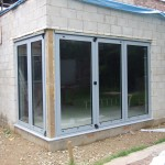 Aluminium bi-fold doors in closed position viewed from outside