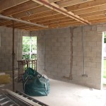 Rear extension progress showing blockwork, openings & ceiling rafters