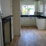 Open plan kitchen & dining area with fitted kitche & oak flooring throughout