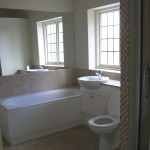 Modernised bathroom with vanity fitted units & inset basin