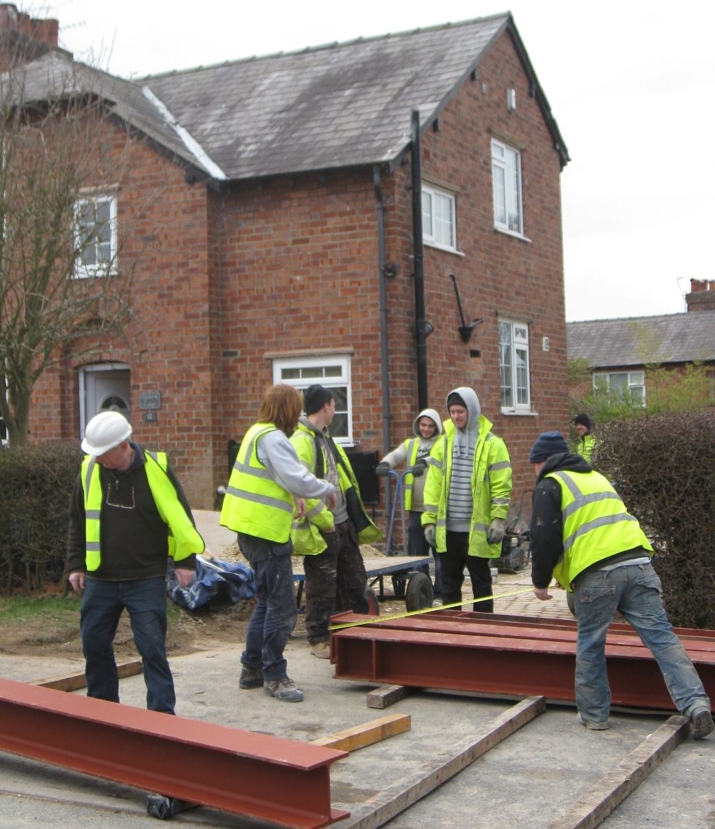 Muscle Power Gather To Relocate Steel Beams