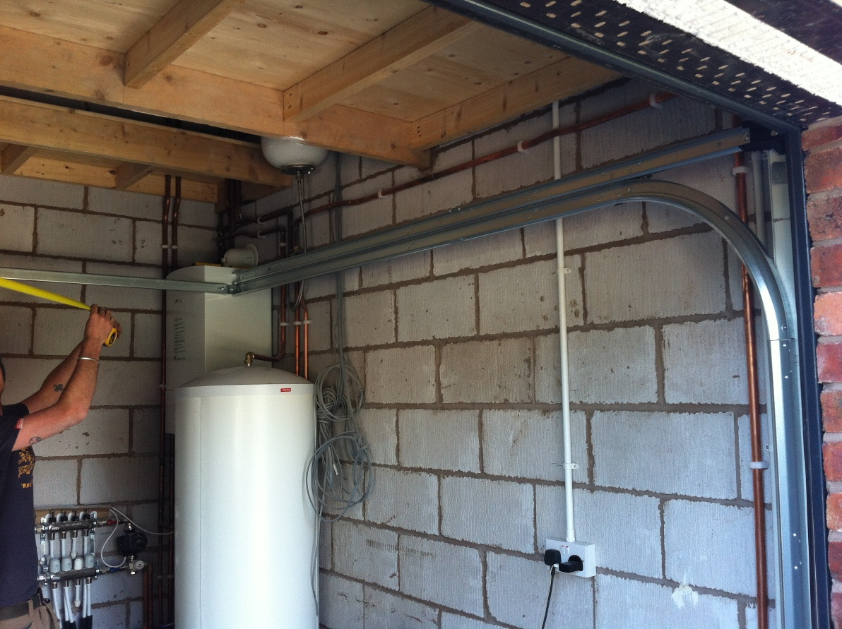 New store area with central heating boiler & pressurised cylinder ...